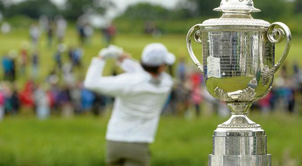 28 June 2013; Rory McIlroy, tees off at the first, infront of the PGA Trophy, during the Irish Open Golf Championship 2013. Carton House, Maynooth, Co. Kildare. Picture credit: Matt Browne / SPORTSFILE