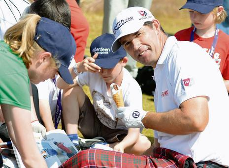 Padraig Harrington enjoys an ice-cream while signing autographs at the Pro-Am for the Scottish Open