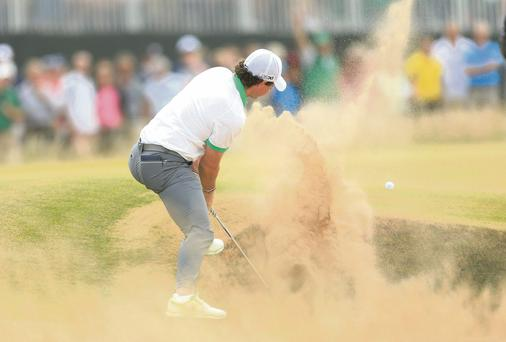 Rory McIlroy had a miserable day at Muirfield yesterday finding a bunker early on in his round