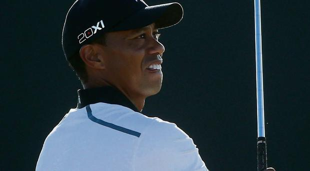 Tiger Woods watches his shot onto the 17th hole at Muirfield