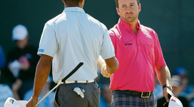 Graeme McDowell and Tiger Woods shake hands at the end of yesterday's round