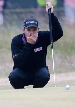 Padraig Harrington lines up a putt during the final round of the British Open at Muirfield