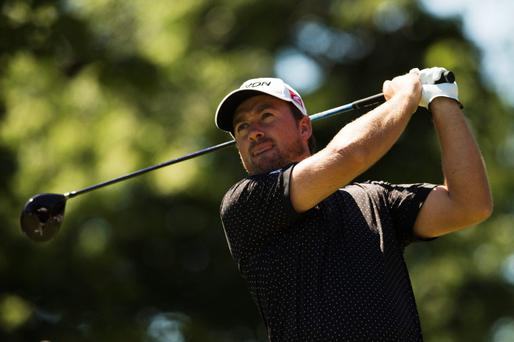Graeme McDowell tees off the tenth hole during the first round at the Canadian Open golf tournament at the Glen Abbey Golf Club in Oakville