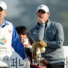 Rory McIlroy, right, of Northern Ireland stands with his caddie JP Fitzgerald on the 14th tee box during the second round of the Korea Open golf tournament at Woo Jeong Hills Country Club near Cheonan, South Korea