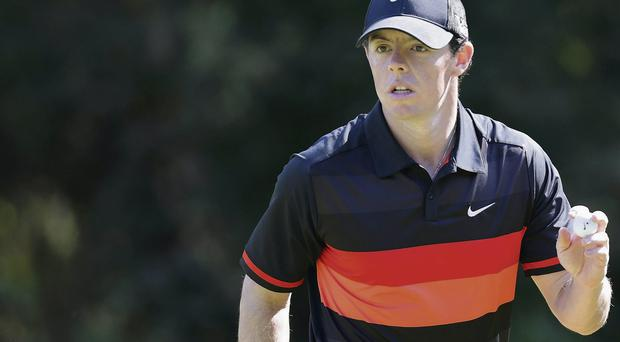Rory McIlroy acknowledges the crowd on his way to second place in Korea