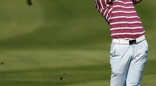 Rory McIlroy plays a shot on the seventh hole at Lake Malaren in Shanghai