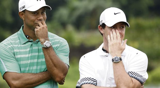 Tiger Woods and Rory McIlroy in conversation during their 'Match at Mission Hills' in Haikou, China, yesterday. The exhibition event was streamed live and saw both golfers wired for sound
