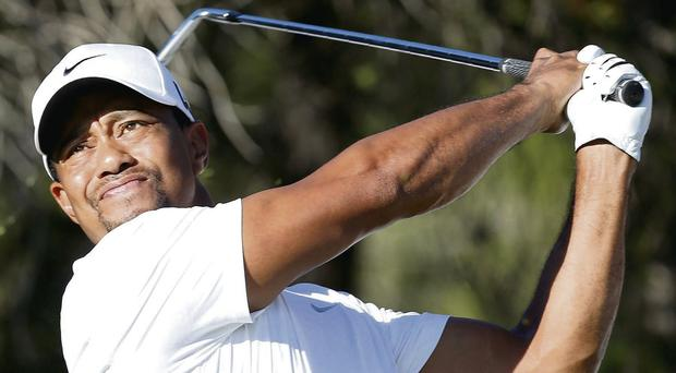 Tiger Woods tees off on the 14th hole during the second round of the Turkish Airlines Open in Antalya yesterday