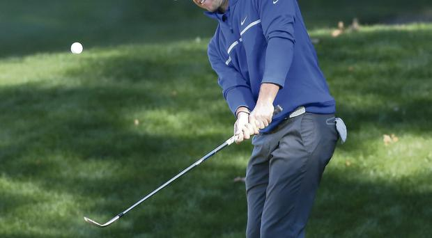 Rory McIlroy plays onto the green on the fifth hole during the Pro-Am at the Sherwood Country Club yesterday