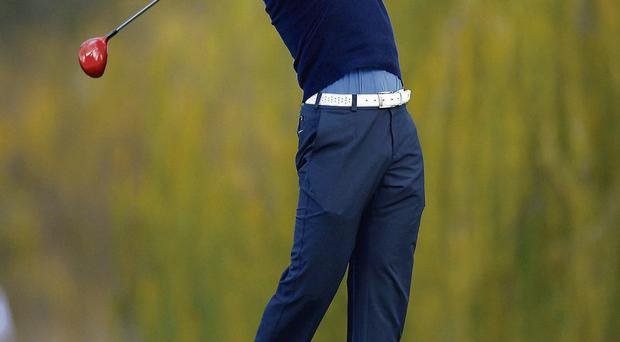 Tiger Woods tees off on the fifth hole during the first round of the Northwestern Mutual World Challenge