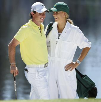 Caroline Wozniacki is building towards the Australian Open in Melbourne in a fortnight, the same week that Rory McIlroy opens his account for 2014 at the HSBC Champions in Abu Dhabi GETTY