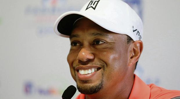 Tiger Woods speaks at a news conference ahead of the Farmers Insurance Open