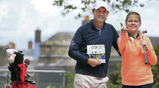 Padraig Harrington at the launch of the development plan of the Confederation of Golf in Ireland (CGI) which outlines the future strategy for golf in Ireland with Anna Karolina (13) Brown from Tempelogue yesterday