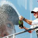 Rory McIlroy gets the champagne flowing at Wentworth on Sunday