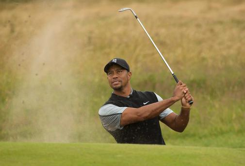 Tiger Woods of the US plays a shot from the bunker near the 15th green during a practice round at Hoylake