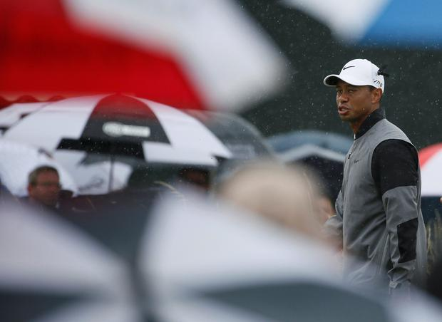 Tiger Woods walks off the 14th tee during the third round of the 2014 British Open Championship