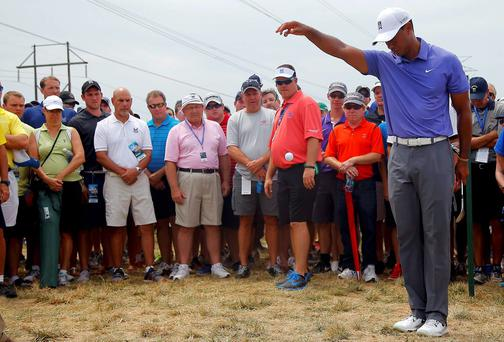 Tiger Woods takes drop after a wayward tee shot on the seventh hole during the first round of the USPGA at Valhalla