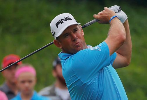 Lee Westwood watches his tee shot on the 16th hole during the first round of the USPGA Championship at Valhalla