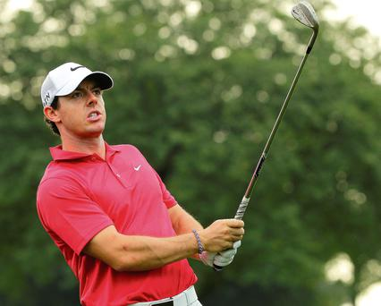 Rory McIlroy reacts to his third shot on the 13th hole during the first round of The Barclays