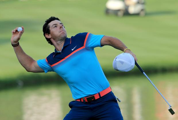 Rory McIlroy throws his ball into the crowd after winning the Dubai Desert Classic