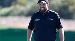 Shane Lowry of Ireland waits to putt on the 12th green of the north course during round two of the Farmers Insurance Open at Torrey Pines Golf Course