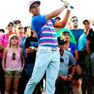 Rickie Fowler plays his second shot on the 16th hole during a playoff at Sawgrass