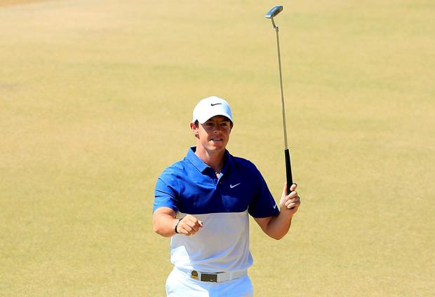 Rory McIlroy celebrates his birdie putt on the 13th green yesterday