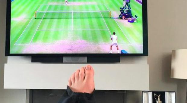 Rory McIlroy posted a picture on Instagram yesterday with his injured foot resting as he watched the tennis