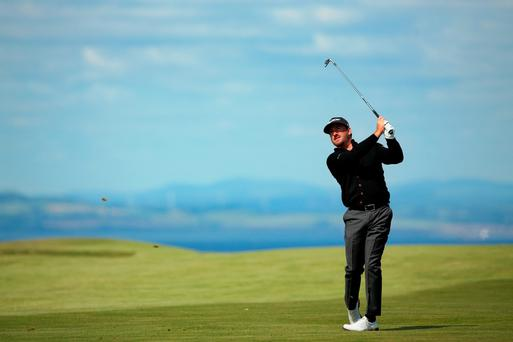 Graeme McDowell hits a shot on the 13th hole during the first round of the Scottish Open at Gullane Golf Club