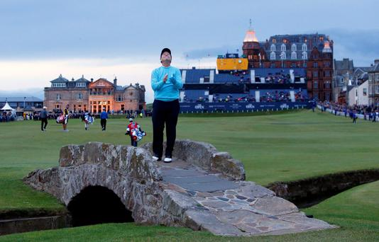 Tom Watson poses on St Andrews' Swilcan Bridge for the final time as a competitor at the end of Friday's second round at the Open.