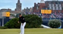 Padraig Harrington watches as his birdie putt makes its way to the hole on the sixteenth green