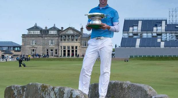 Alex Gleeson with the winning trophy at St Andrews