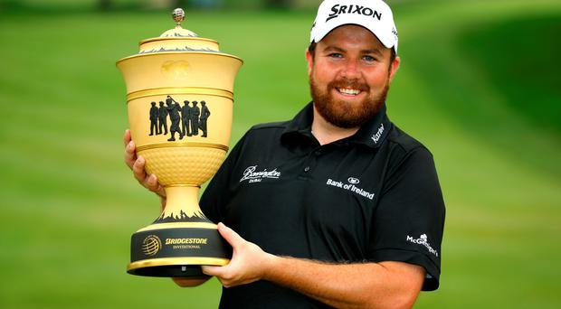Shane Lowry holds the Gary Player Cup after winning the WGC Bridgestone Invitational in Ohio this week.