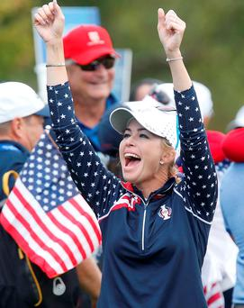 Paula Creamer celebrates after making the final point to win the Solheim Cup