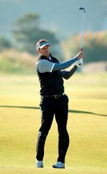 Former German footballer Michael Ballack plays his second shot to the second hole during the first round of the Alfred Dunhill Links Championship