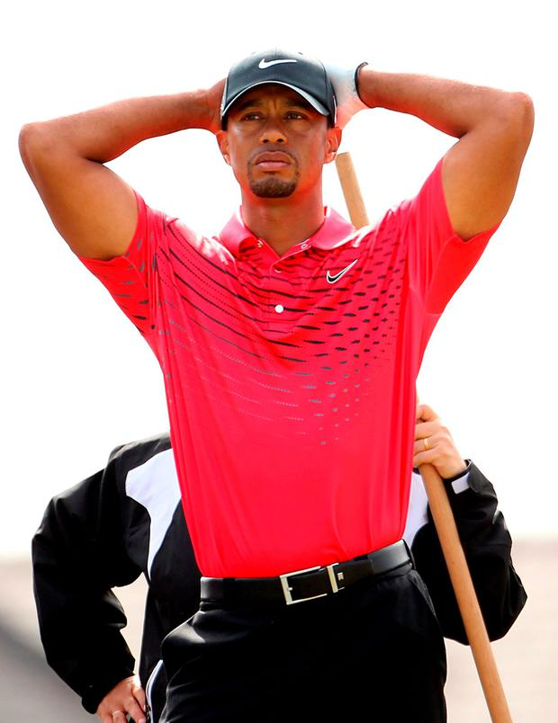 File photo dated 22-07-2012 of USA's Tiger Woods on the ninth hole PRESS ASSOCIATION Photo. Issue date: Monday October 26, 2015. Despite his many successes, 14-time major winner Tiger Woods is not known for his cool temperament and all too often his bad temper has let him down at key moments in tournaments. See PA story SPORT Tantrums. Photo credit should read Lynne Cameron/PA Wire.