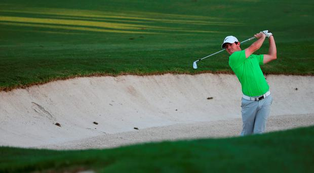 Rory McIlroy plays his second shot on the par-five 18th
