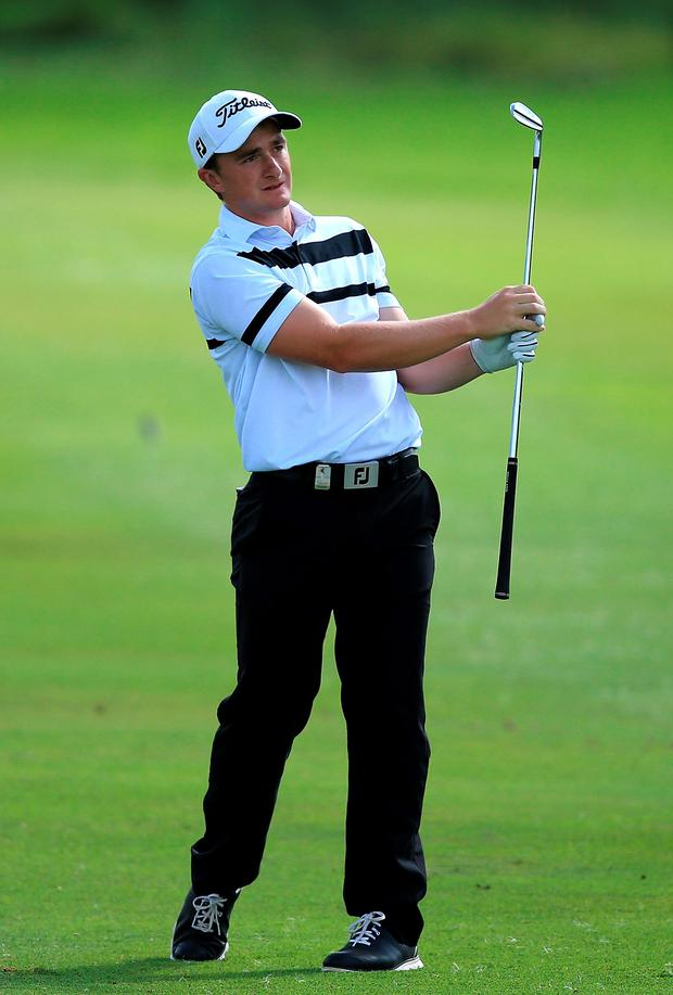 Paul Dunne playing his practice round in South Africa