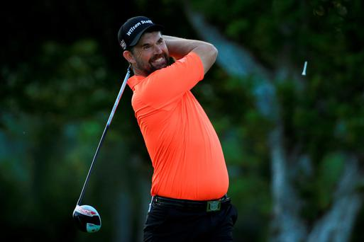 Padraig Harrington plays his shot from the first tee during the first round of the Sony Open in Hawaii (Getty)