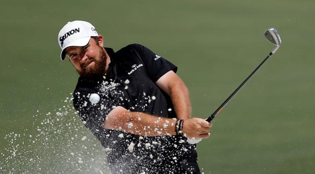 Shane Lowry hits out of a bunker on the second hole during the final round of the Masters. Photo: AP