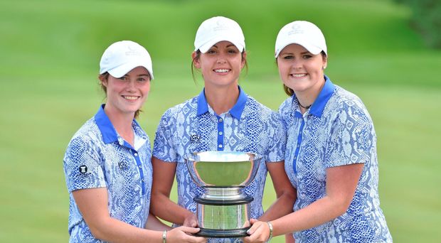 Irish players, from left, Leona Maguire, Maria Dunne and Olivia Mehaffey, of GB&I, celebrate with the Curtis Cup after GB&I beat the USA. Photo: Sportsfile