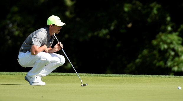 Rory McIlroy lines up a putt on the 15th green during the continuation of the second round of the US Open at Oakmont yesterday. Photo: USA Today Sports