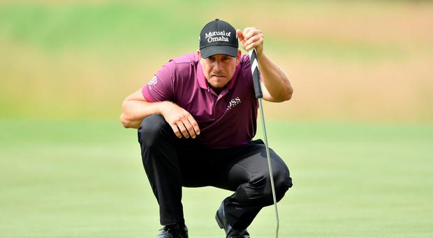 Henrik Stenson of Sweden lines up a putt during the second round of the BMW International Open