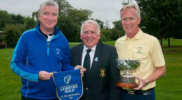 Greystones GC manager Gerry Browner, Leinster Golf official John Ferriter and Greystones captain Tom Byrne with the Fourball pennant and trophy