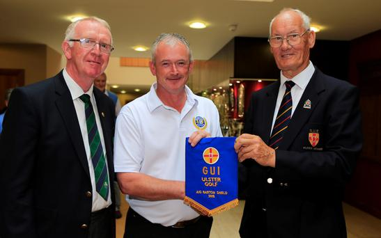 Eamonn O'Connor (right), presents Colm Campbell with the pennant Picture: Newsfile