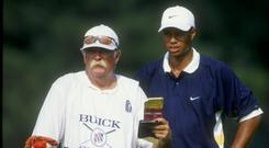 Mike 'Fluff' Cowan and Tiger Woods were a formidable team during the nineties, but Tiger then showed him the door and the veteran caddie has since been on the bag of Jim Furyk. Photo: Getty