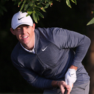 Rory McIlroy looks anxiously at his shot after escaping a bunker on the 10th hole in Abu Dhabi. Photo: AP
