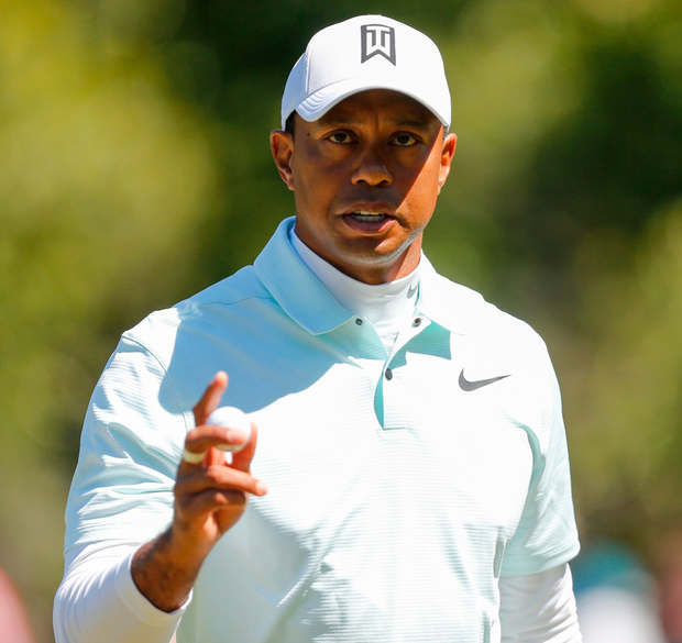 Tiger Woods reacts after sinking a birdie putt during his second round. Photo: Getty Images