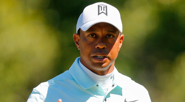 Woods two strokes off lead