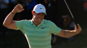 A victorious Rory McIlroy celebrates after making his birdie putt on the 18th green at the Arnold Palmer Invitational. Photo: Getty Images